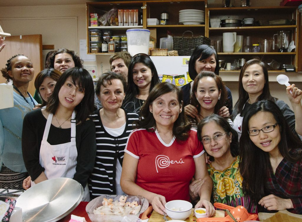 Diverse group of women participate in a community kitchen at Little Mountain Neighbourhood House