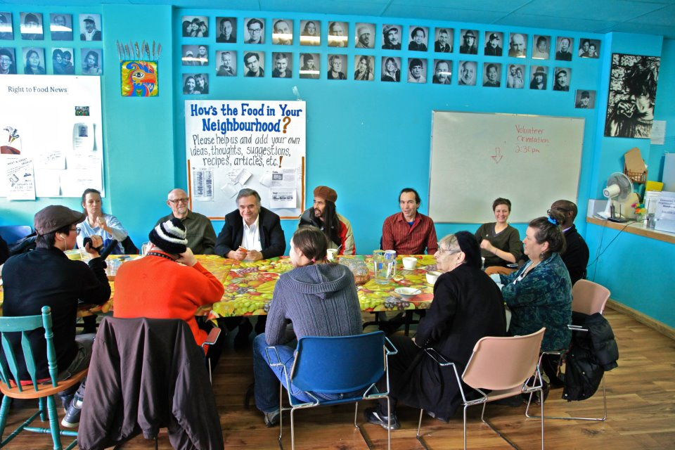 An image of a group of people working together around a table