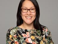 A portrait of Sarah Kim, smiling